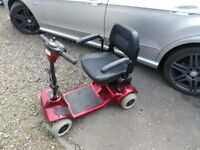 mobility scooter goes in car boot folds down easy new battery pack £250