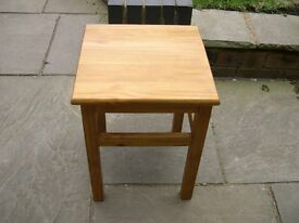 A square pine plant stand/ lamp table.