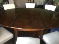 Large oval dark wood dinning table