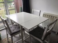 Drop leaf dining table for 2 to 4 and chairs (4), less than 1 year old, good condition!