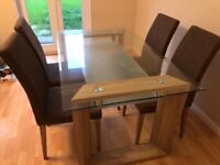 NEW GLASS AND OAK DINING ROOM TABLE AND CHAIRS