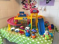 Fisher Price garage and cars