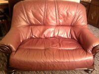 leather 2 seater settee with 1 chair very comfortable red leather