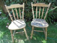 2 solid pine chairs and yellow plastic ikea folding chair