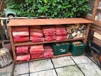 Sacks of dried logs and kindling for sale