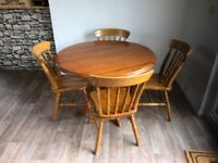 hardwooden table and chairs in good condition