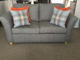 As new 2 x 2 seater sofas (1 is a sofa bed) for sale in perfect condition - as new