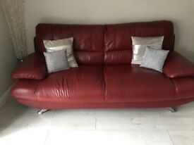 Selling 2 x 3 seater leather sofas only 2 years old.