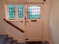 Original Victorian front door with side windows