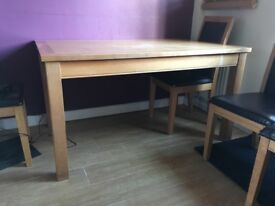 Solid oak extending dining table, good condition except the top which needs some work