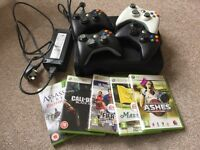 Xbox 360 bundle with 4 wireless controllers and 5 games