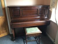 Free Standing Piano and Stool
