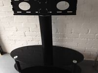 TV stand excellent condition will hold flatscreen and wide TV black glass no chips or damage