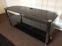 TV STAND BLACK GLASS, SCRATCH LESS GLASS CLEAN CONDITION, SIZE Width 115cm, Deep 40cm, Height 50cm.