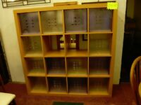 Organizer shelving unit with 14 storage boxes all included.
