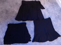 THREE short black SKIRTS from WAREHOUSE. Different styles, rarely worn. Exc condition. Approx size 8
