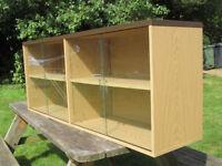 Swish showcase / book shelves with glass sliding doors