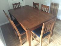 Stylish solid dark wood dining table and 6 chairs