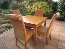 4 Wicker Chairs and a Table
