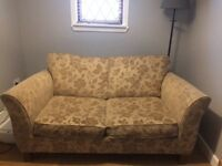 Beige Marks & Spencer two seater sofa bed