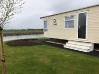 Haggerston Castle Luxury 6-berth Mobile Home to rent. Lake views - quiet & secluded location.