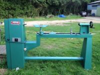 Large woodturning lathe, will turn 48'' long columns and has new headstock bearings.