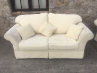 Two cream sofas 2 and 3 seater