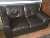 Leather two seater sofa for sale.