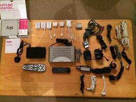 Router, tv, phone, audio cable, chargers, remotes