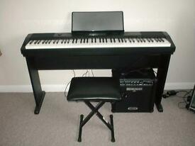 CASIO 220R DIGITAL PIANO AND GUITAR AMP.