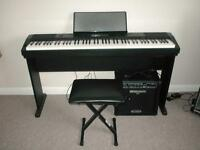 CASIO 220R DIGITAL PIANO AND GUITAR AMP.
