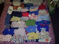 Large bundle of baby boys clothes sizes from newborn too 18-24