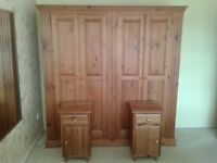 A pair of bedside wooden cabinets.