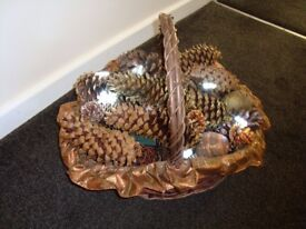 Basket full of fir cones and lights.