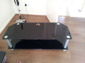 T.V. Table. Modern look. Glass and metal Black