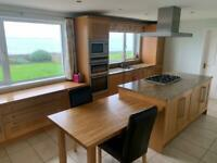 Solid wooden fitted kitchen with granite work surfaces and integrated neff appliances