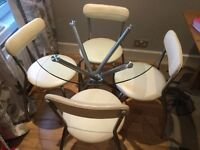 Glass bistro table and 4 cream chairs