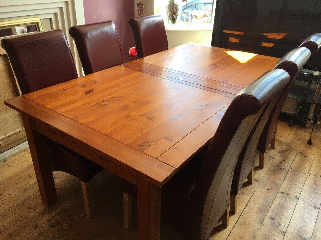 Matching, extending dining tablel and chairs, sideboard and hall table set for sale.