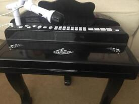 Kids toy piano and microphone