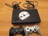 Playstation 2 console with controllers and Fifa 09