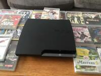 PS3 with 2 controllers and 26 games (3 without cases)