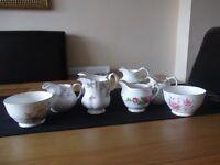 13 crystal bud vases, x7 floral milk jugs, x2 sugar bowls