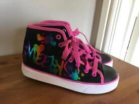 Girls genuine Heelys size 3