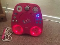 Karaoke machine lights up with microphone mains charger and Disney princess cd