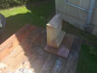 Sandstone memorial or small headstone.
