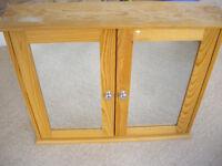 Bathroom cabinet, wood, mirror front, pull open doors.