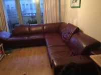 Burgundy 6-7 seat corner sofa. Kept in very good condition. Real leather. Reclining headrests.
