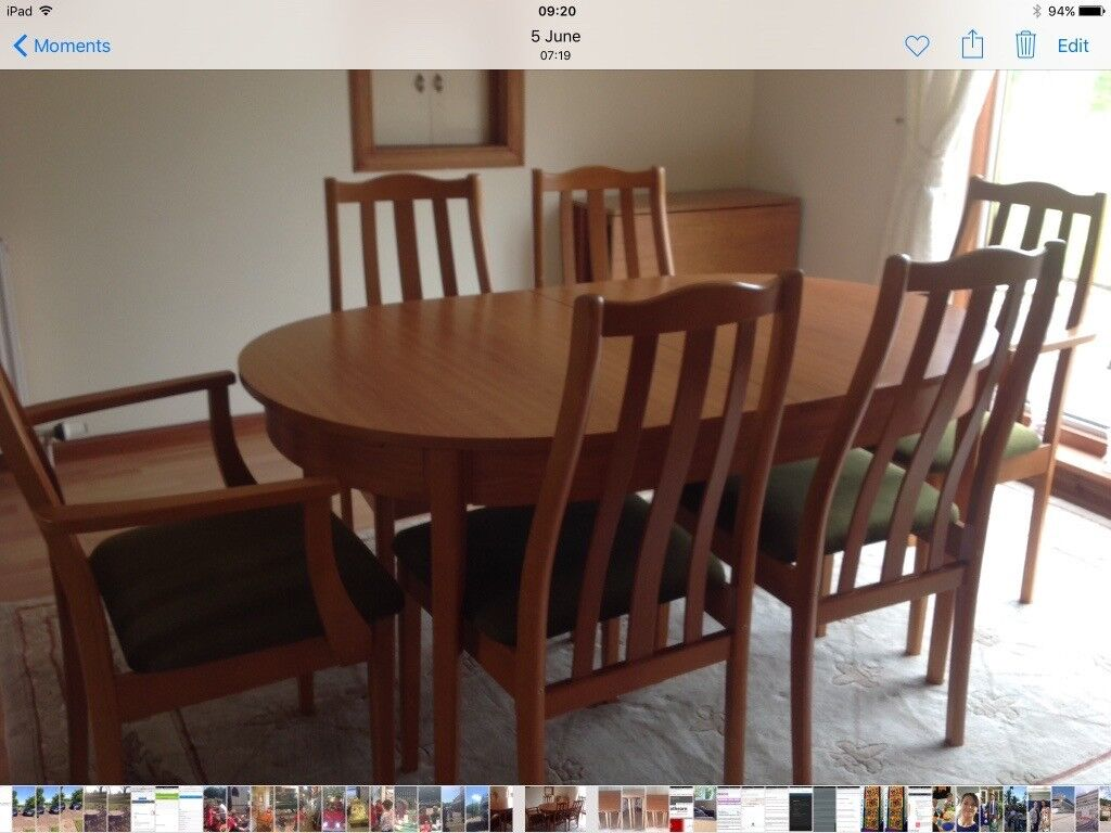Teak dining room table and six chairs