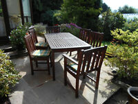 Solid Teak Patio set, 4 chairs 2 armchairs and a large 6 foot table