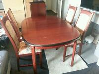 Extendable wooden dinning table with 4 chairs